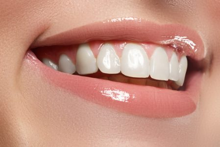 Smiling person showing off perfect teeth