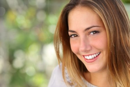 Beautiful woman with a whiten perfect smile outdoor