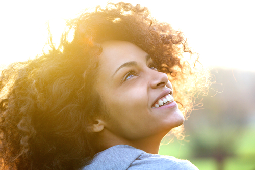 Close up portrait of a beautiful young african american woman smiling and looking up-img-blog