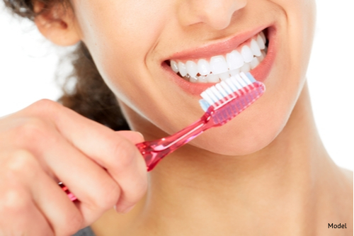 Girl practicing good oral hygiene by brushing after each meal-img-blog