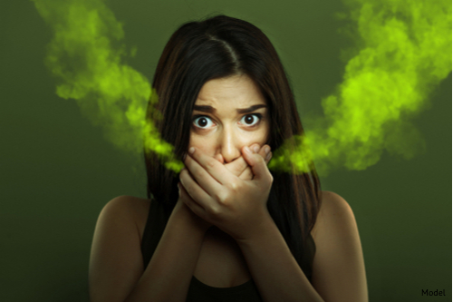 Girl with chronic bad breath looking for bad break solutions-img-blog