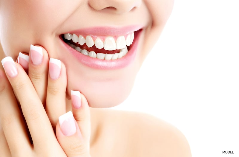 Woman smiling with healthy, white teeth.