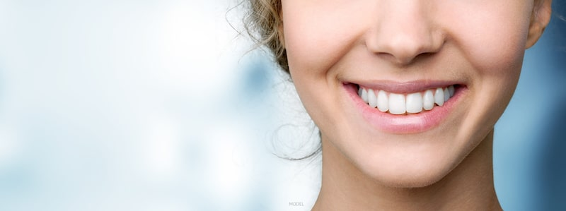 Young woman smiling, close up of teeth